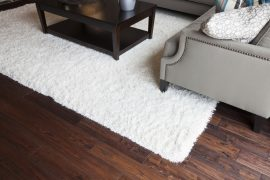 How to clean an area rug on hardwood floor?